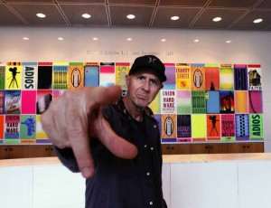 "Artist Craig Stecyk stands in front of his installation, ""Faith, Hope and Charity,"" in the lobby of MOCA. (Anne Cusack, Los Angeles Times / March 25, 2013)"